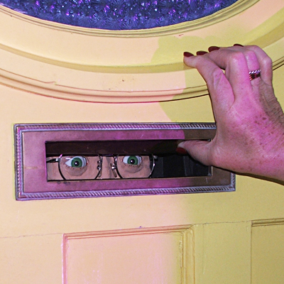 Eyes peering from letter slot