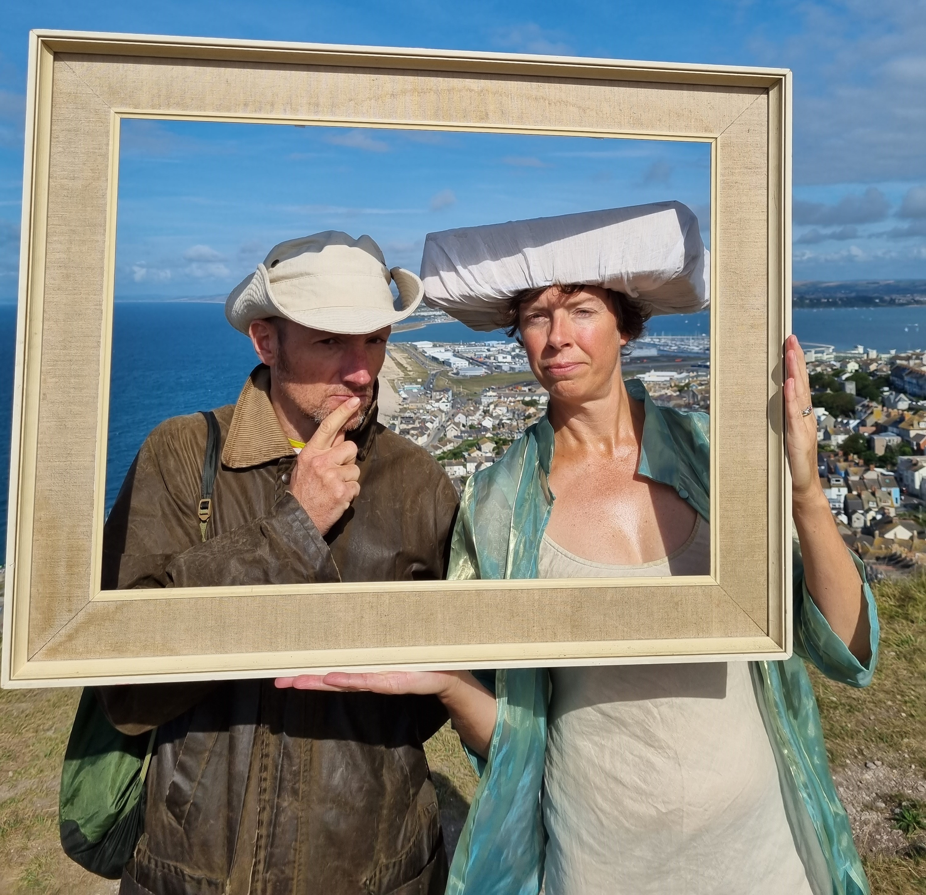 Simon and Jess with a frame and Chesil Beach